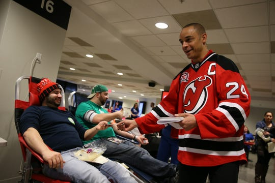 A former New Jersey Devils player, Bryce Salvador, mingles with donors at the 2018 New Jersey Devils blood drive, in partnership with RWJ Barnabas Health and the American Red Cross.