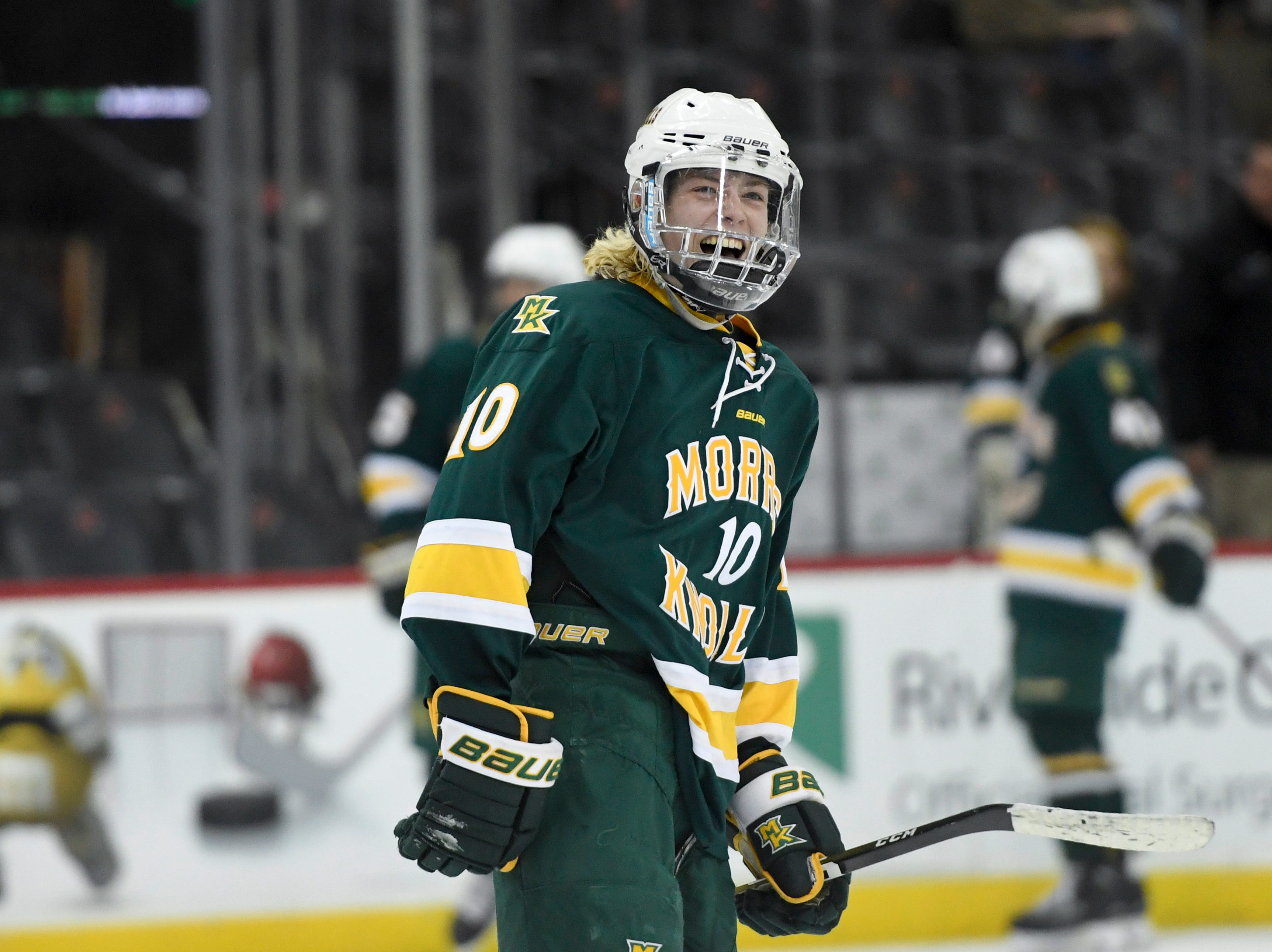 Morris Knolls/Hills' Sean Murray (10) smiles towards the student section after a goal in the third period. Morris Knolls/Hills defeats Hillsborough 6-1 in the Public A ice hockey final at the Prudential Center on Monday, March 4, 2019, in Newark.