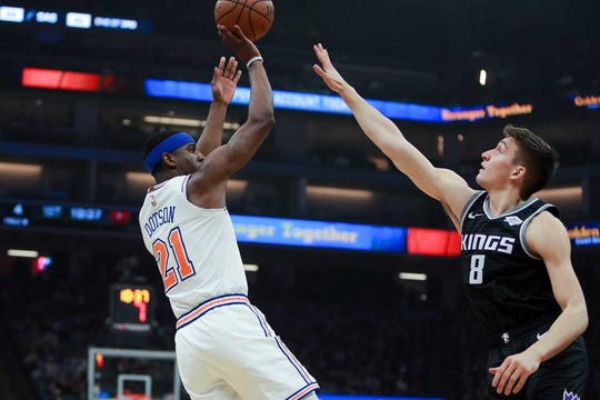 New York Knicks guard Damyean Dotson (21) shoots the ball over Sacramento Kings guard Bogdan Bogdanovic (8) during the first quarter at Golden 1 Center.