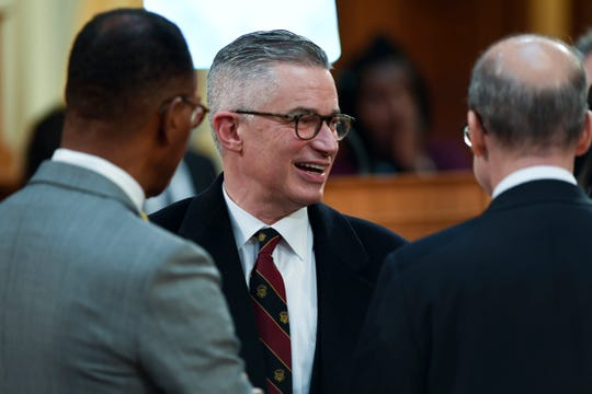 Former New Jersey Governor Jim McGreevey, center, on the floor before Governor Phil Murphy delivers a speech on the state budget on Tuesday, March 5, 2019, in Trenton.