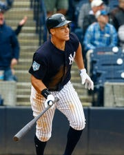 Mar 5, 2019; Tampa, FL, USA; New York Yankees right fielder Aaron Judge (99) hits a three run homer during the fifth inning of a game against the Atlanta Braves at George M. Steinbrenner Field.