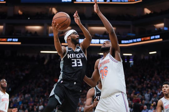 Sacramento Kings guard Corey Brewer (33) shoots the ball as New York Knicks center Mitchell Robinson (26) defends during the third quarter at Golden 1 Center.