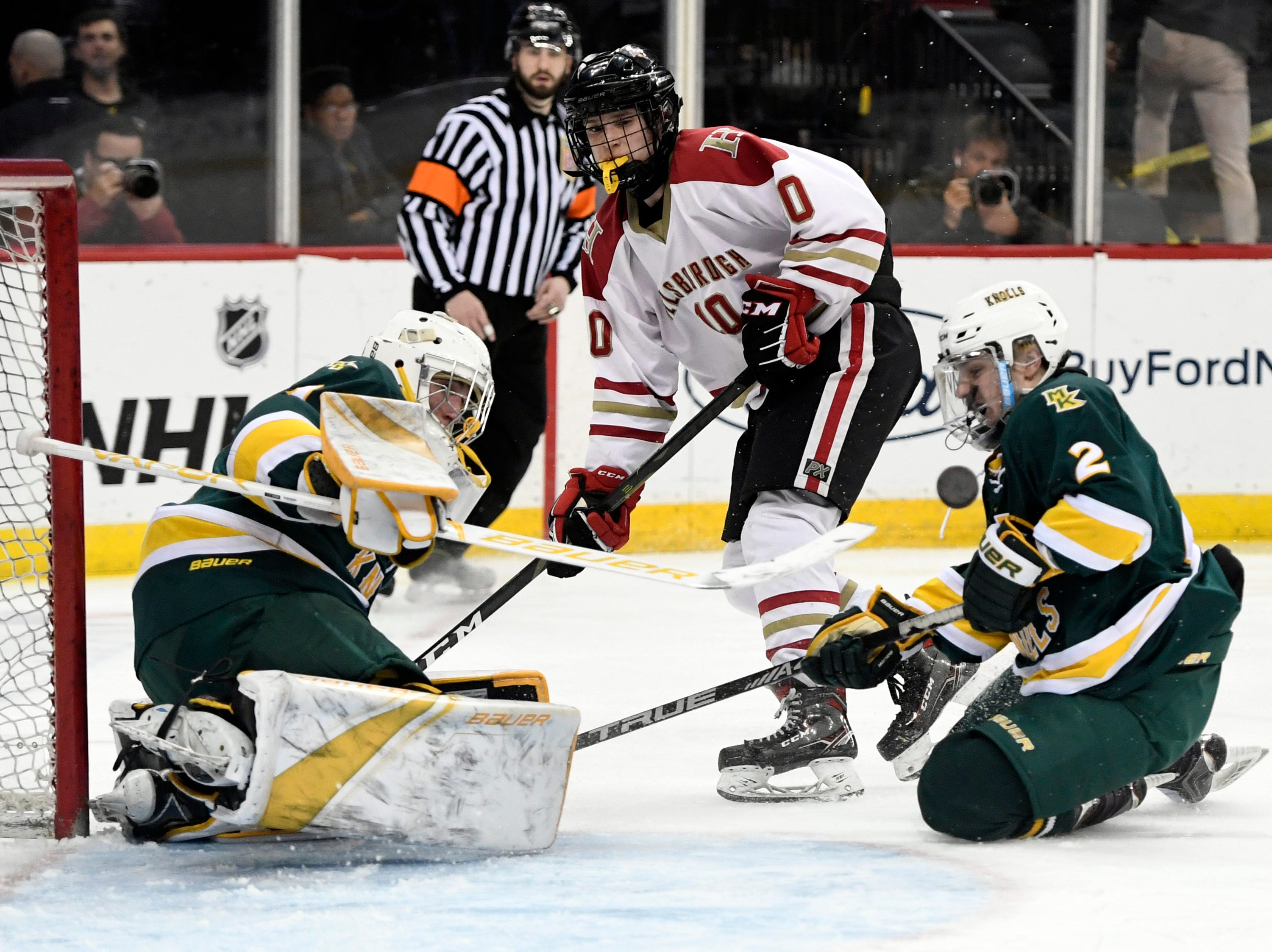 Morris Knolls/Hills goalie Ty Franchi blocks a shot by Hillsborough's Jude Kurtas (10) in the third period. Morris Knolls/Hills defeats Hillsborough 6-1 in the Public A ice hockey final at the Prudential Center on Monday, March 4, 2019, in Newark.