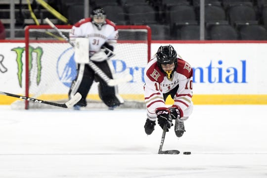 Hillsborough's Jude Kurtas trips with the puck in the Public A ice hockey final against Morris Knolls/Hills at the Prudential Center on Monday, March 4, 2019, in Newark.