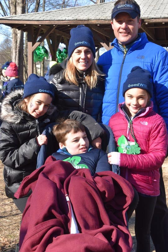 The Sullivan family bundles up against the cold during GoodWill's first Shamrock Shuffle 5k in Ridgewood