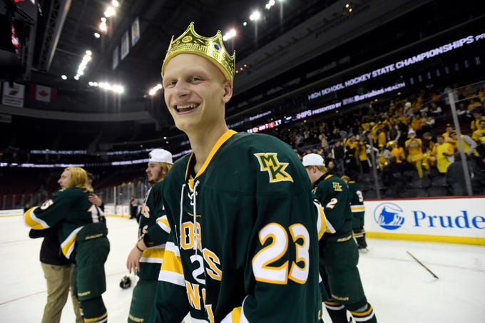 Morris Knolls/Hills' Kyle Conklin celebrates on the ice with his teammates after defeating Hillsborough 6-1 in the Public A ice hockey final at the Prudential Center on Monday, March 4, 2019, in Newark.