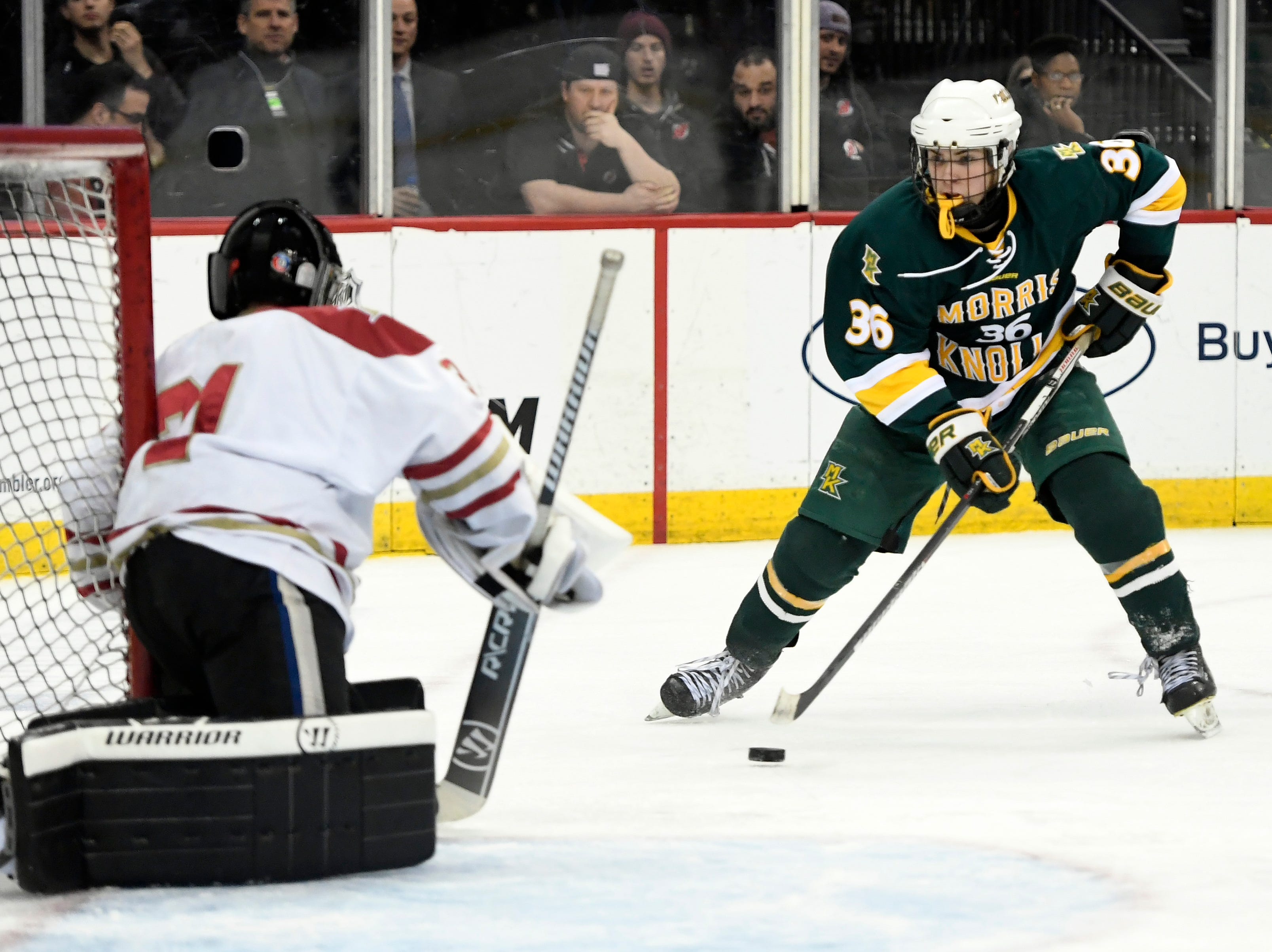 Morris Knolls/Hills' Jason Kwestel (36) scores in the second period against Hillsborough in the Public A ice hockey final at the Prudential Center on Monday, March 4, 2019, in Newark.