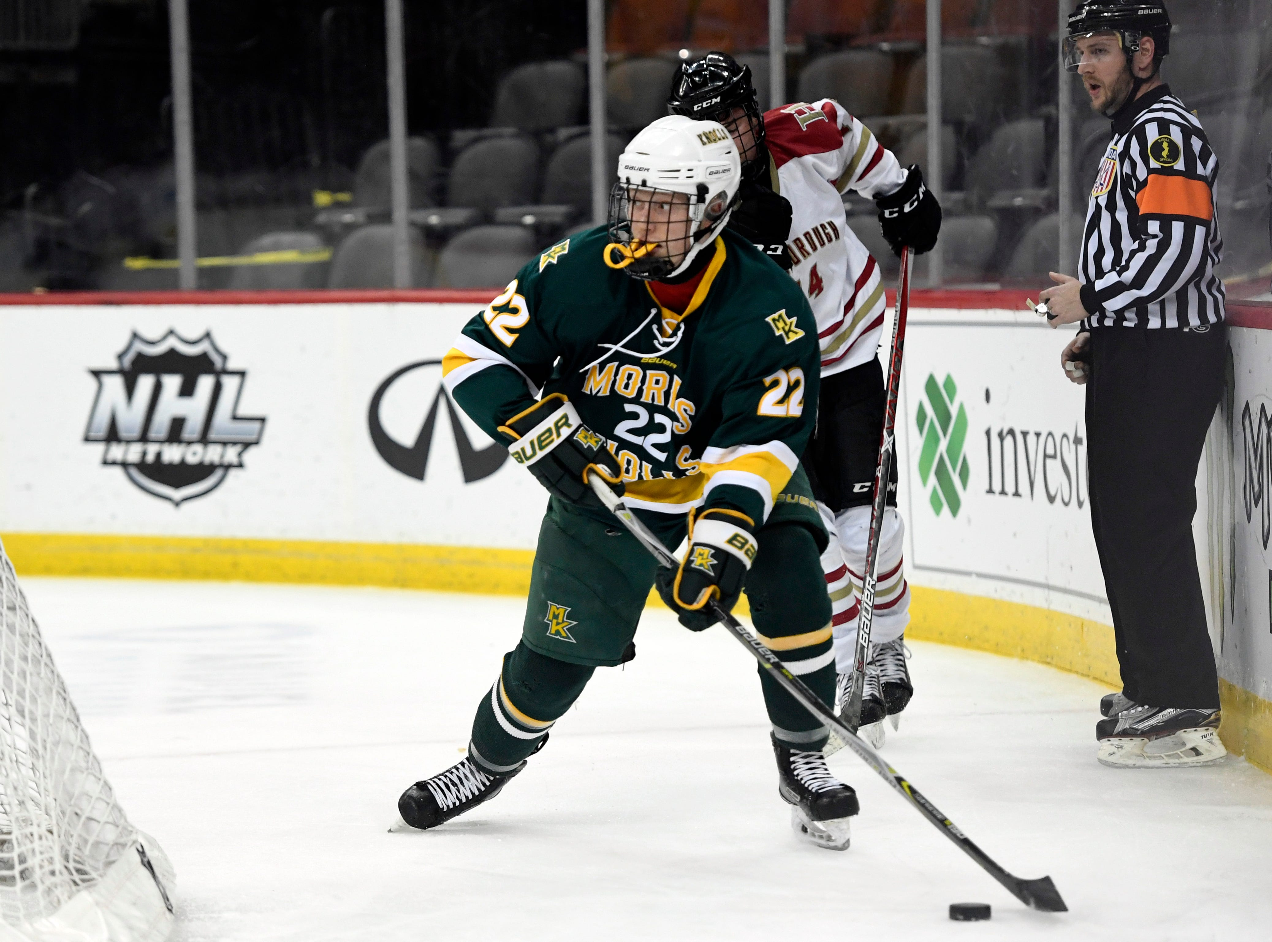Morris Knolls/Hills' Jason Miesegaes (22) clears the puck from the Knolls/Hills end of the ice in the Public A ice hockey final at the Prudential Center on Monday, March 4, 2019, in Newark.