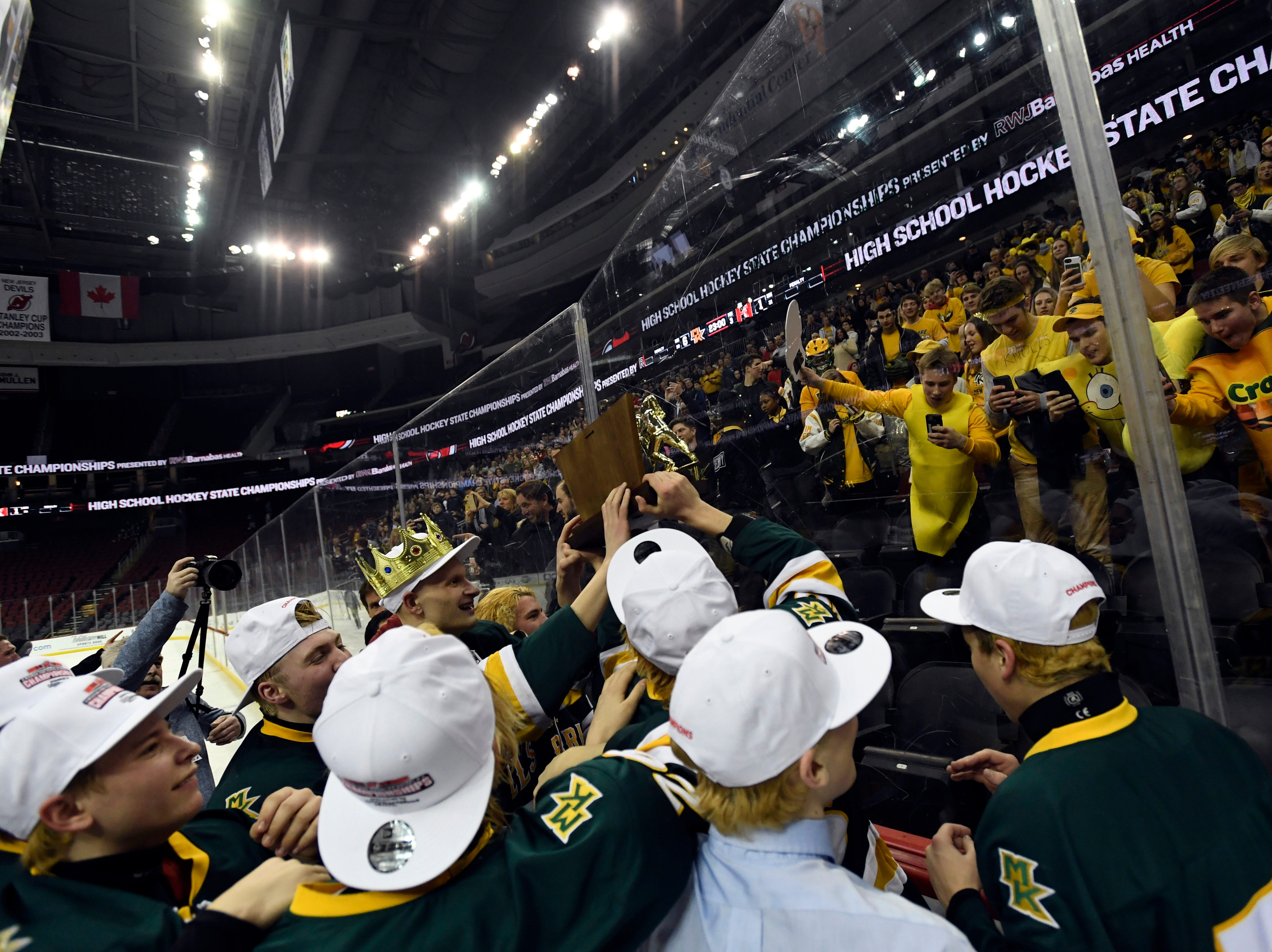 Morris Knolls/Hills players celebrate with the student section after defeating Hillsborough 6-1 in the Public A ice hockey final at the Prudential Center on Monday, March 4, 2019, in Newark.