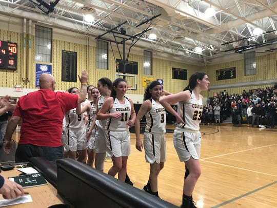 Cresskill senior tri-captains Courtney Madison (23), Jennifer Garcia (3) and Sophie Green (11) lead the handshake line after the Cougars topped Park Ridge, 51-40, in the North 1, Group 1 girls basketball final on Monday, March 4, 2019.