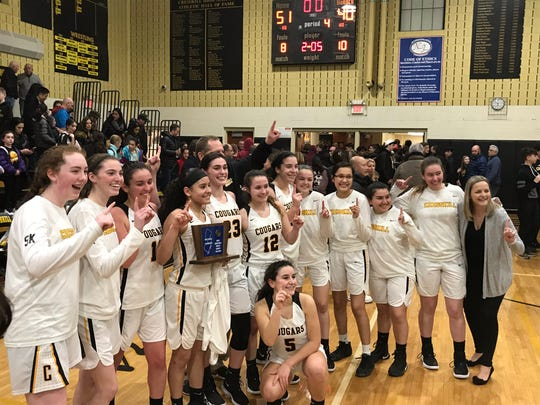 The Cresskill girls basketball team celebrates its second consecutive North 1, Group 1 championship after defeating division rival Park Ridge, 51-40, on Monday, March 4, 2019.