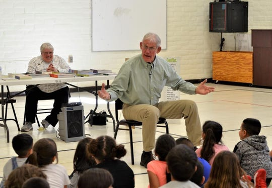 Gila Reading Council member Harriet Juricich watches as children's author Joe Hayes tells students at Bell Elementary a story during the Literacy Showcase week at Deming Public Schools.