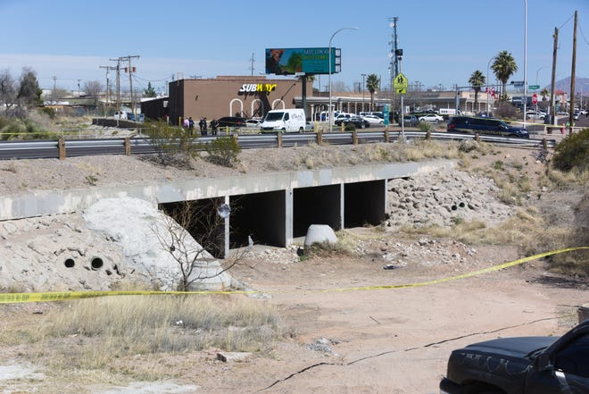 Las Cruces police investigate after a body was found Tuesday, March 5, 2019, near the arroyo that passes under Lohman Avenue.