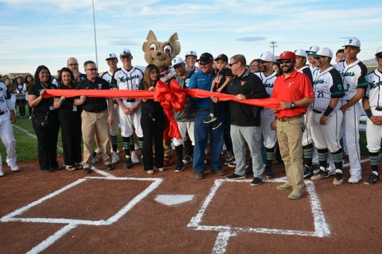 Members of the Gadsden ISD administration, Santa Teresa High School administration, and members of the El Paso Chihuahua PCL baseball team officially cut the ribbon for the new baseball field renovation donated by Howdy's, Marathon Oil, and the El Paso Chihuahua baseball team.