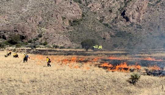 Bureau of Land Management firefighters conduct a prescribed burn near Dripping Springs Natural Area on Tuesday, March 5, 2019.