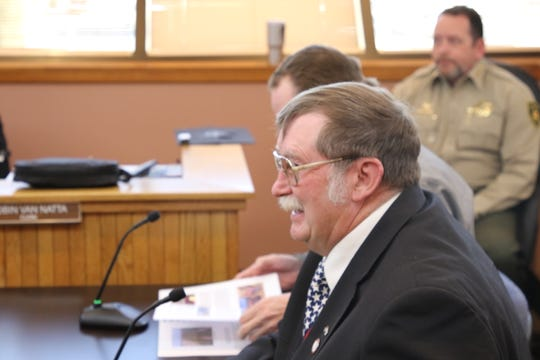 Eddy County Agriculture Extension Agent Woods Houghton shares a laugh with Eddy County Board of Commissioners March 5.