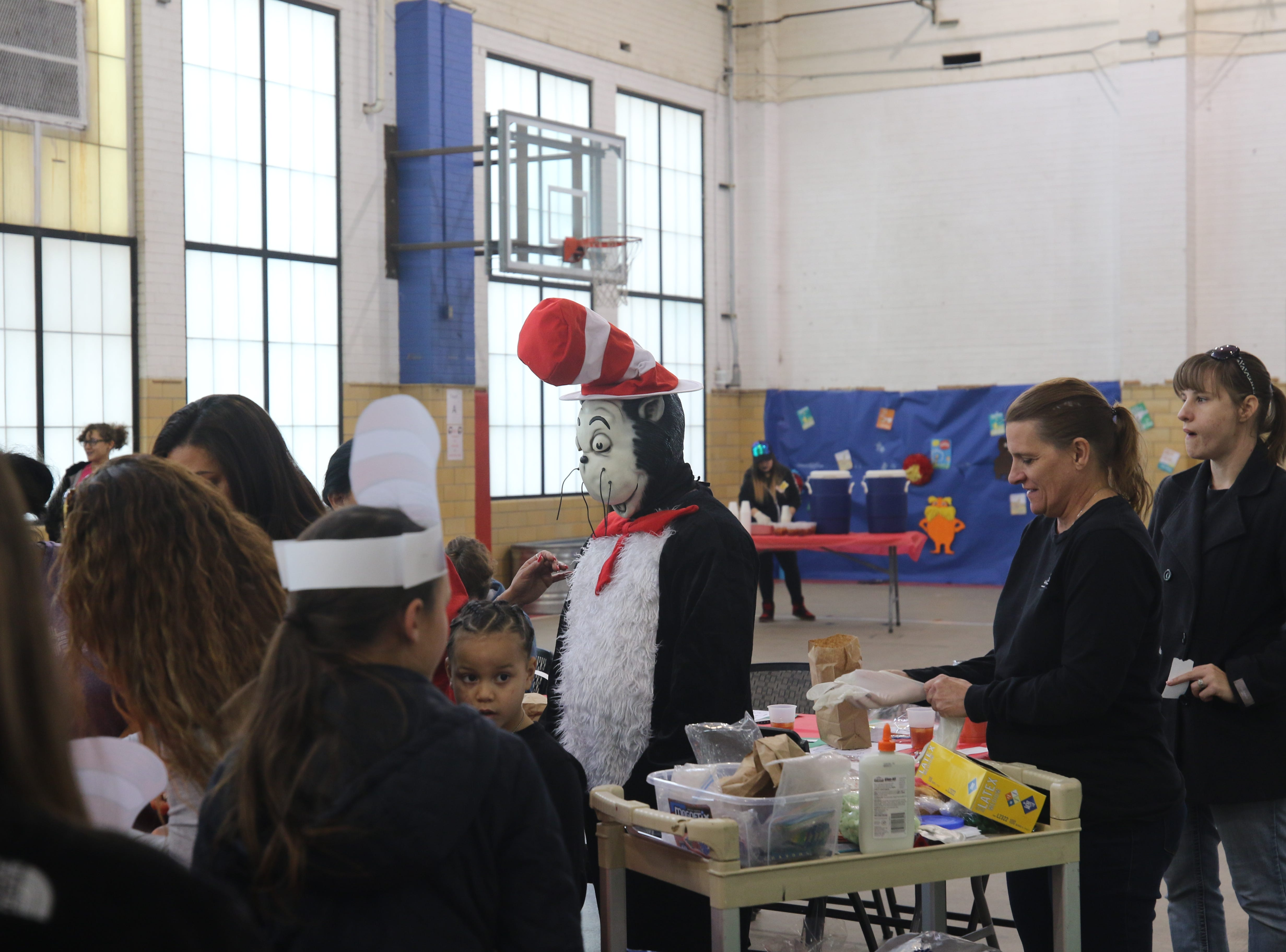 The Cat in the Hat poses with children March 6 at the Riverwalk Recreation Center which celebrated Dr. Seuss' birthday.