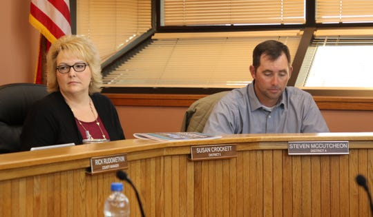 District 5 Eddy Board of County Commissioner Susan Crockett (left) and District 4 Commissioner Steven McCutcheon listen during a discussion at the March 5 commission meeting.