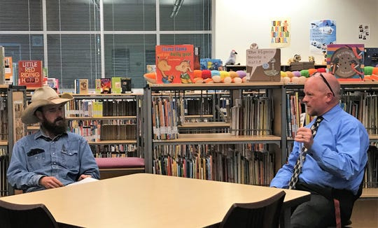 APS Superintendent Jerrett Perry, right, talks about the Two Mill Capital Improvement Levy vote to Colt Howland and Daniel Cass (not pictured). APS held a public forum at Desert Star Elementary on Feb. 27.