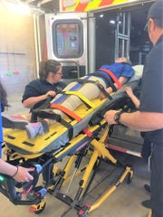 Ruidodos Middle School students experience what it is like to use a motorized gurney. LCMC emergency responders are trained using the latest equipment.