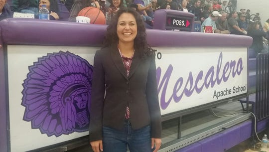 Xochitl Torres Small visits Mescalero Apache School during a basketball game. During the game she took time to visit with students, staff, and the basketball team.