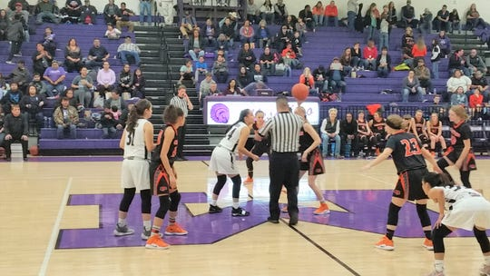 The Mescalero Apache Lady Chiefs show off their skills during a basketball game. The win will take them into the district championship to be hosted at Mescalero Apache School on March 8.