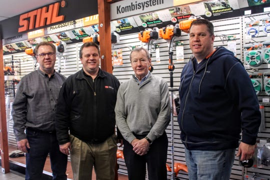 From left to right: Ron Weingartz, Dan Weingart, John Murphy and Ken Weingartz. Murphy has sold Commercial Lawnmower to Weingartz, marking the Utica-based business's first store in Wayne County.