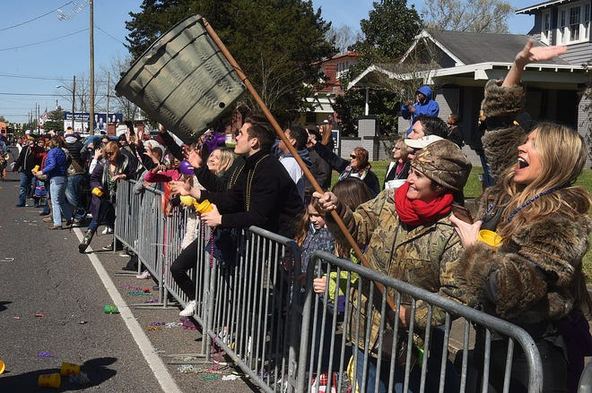 """The shouts of """"throw me something mister"""" rang through downtown as, despite the cold weather, large crowds gathered to witness the Imperial Opelousas Mardi Gras Parade Tuesday."""