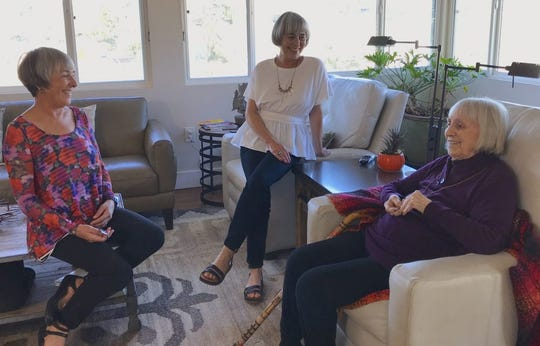 Ginny Davenport,100, of San Diego enjoys a chat with her daughters Kelly Davenport (center) and Riley Davenport (left). The daughters are part of a growing trend of older adults caring for their elderly parents.