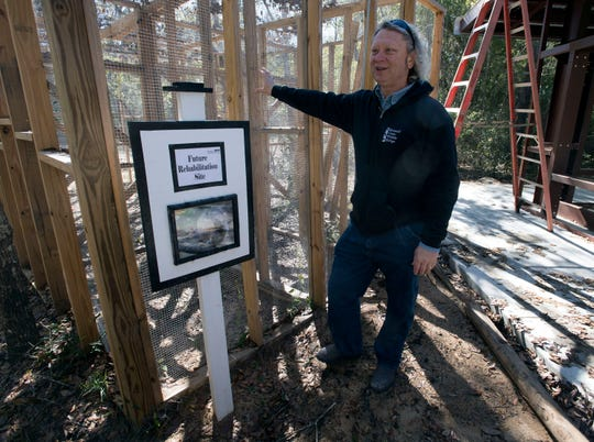 Emerald Coast Wildlife Refuge director emeritus Bill Andersen talks Tuesday about work being done at the organization's new home off Florida State Road 87in Navarre.