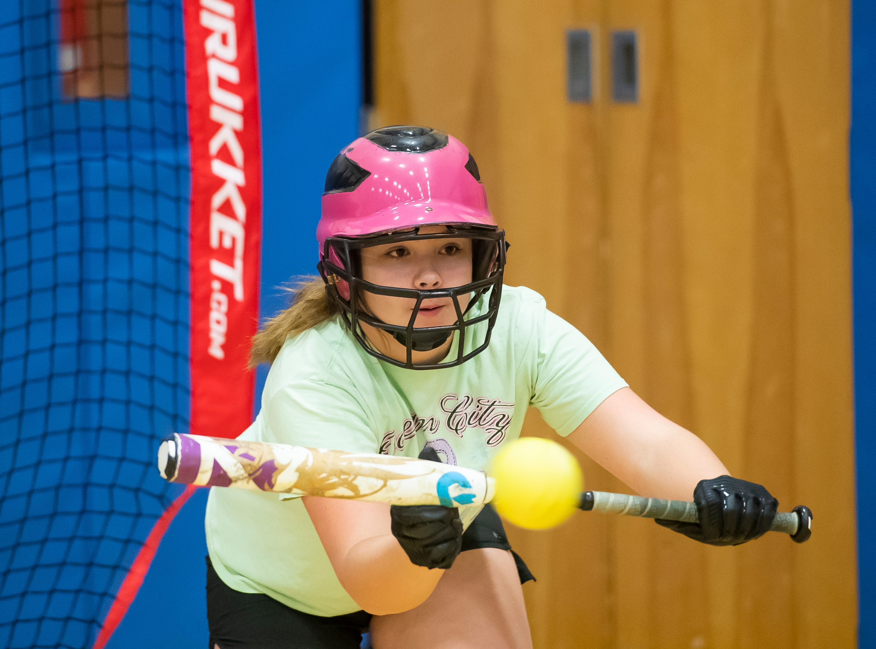 Littlestown's Destiny Henderson practices bunting on the first day of spring sports practice inside the Littlestown High School gym Monday, March 4, 2019.