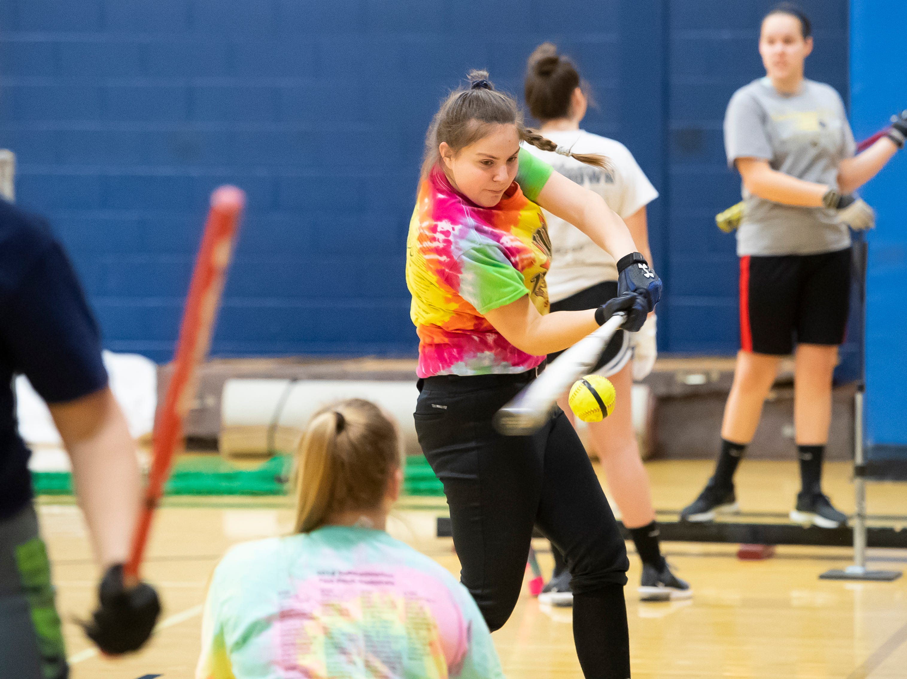 Littlestown's Rebecca Green connects with the ball during a hitting drill on the first day of softball practice inside the Littlestown High School gym Monday, March 4, 2019.