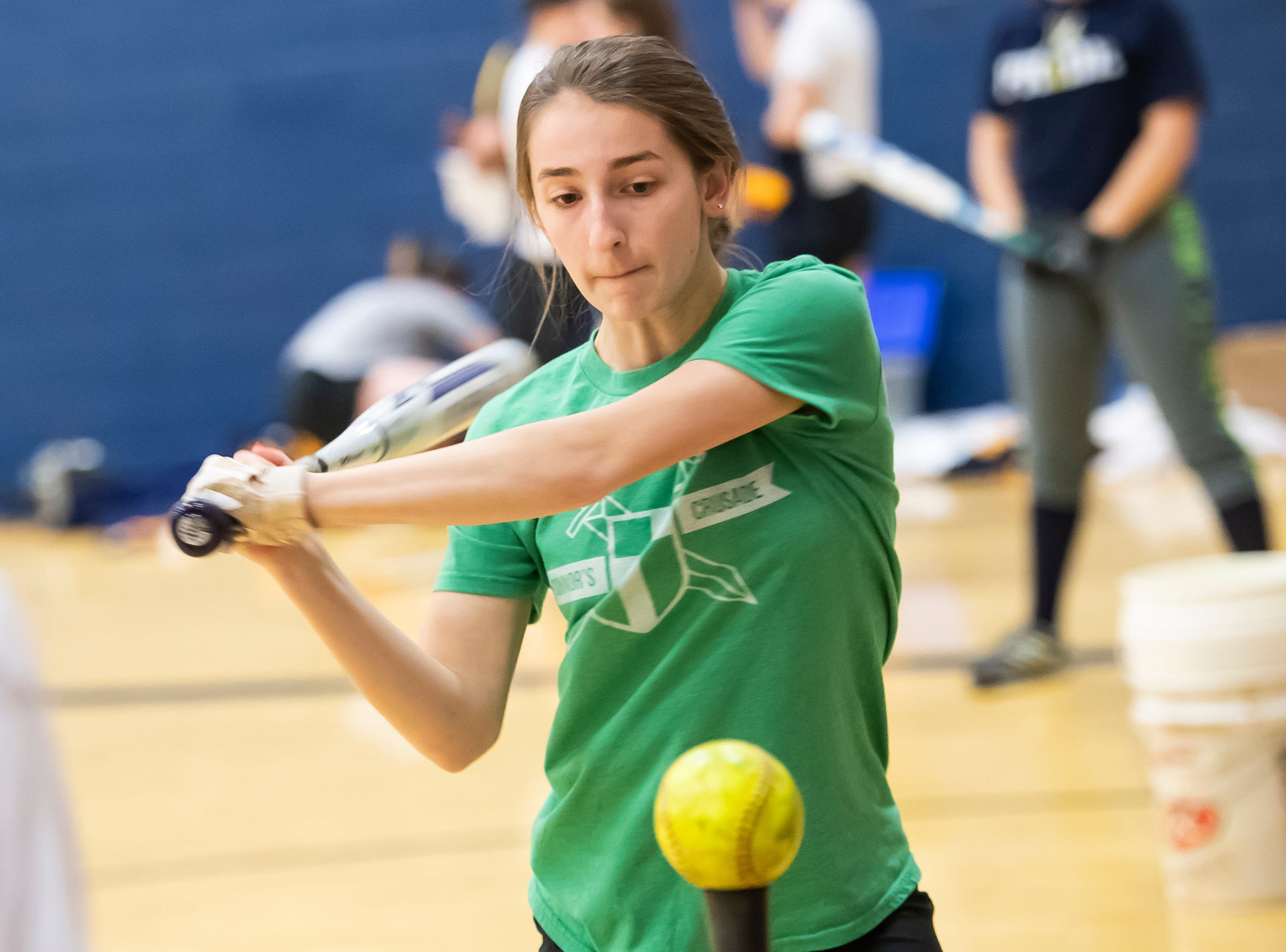 Littlestown's Hayli Hartlaub prepares to hit a softball off a tee during the first day of spring sports practice in the Littlestown High School gym Monday, March 4, 2019.