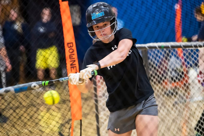 Littlestown's Kacie Frock swings during a hitting drill inside the batting cage on the first day of softball practice in the Littlestown High School gym Monday, March 4, 2019. Chilly temperatures and snow covered fields and courts forced most teams inside for the first week of spring sports practice.