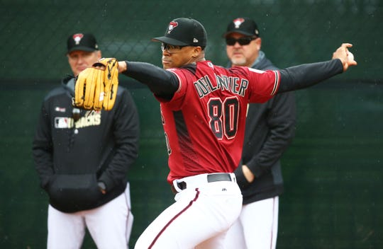 Diamondbacks pitcher Jon Duplantier throws during a spring training workout on Feb. 14 at Salt River Fields.