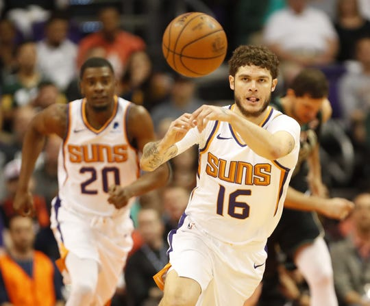 Phoenix Suns guard Tyler Johnson (16) passes the ball against Milwaukee Bucks during the first quarter in Phoenix March 4, 2019.