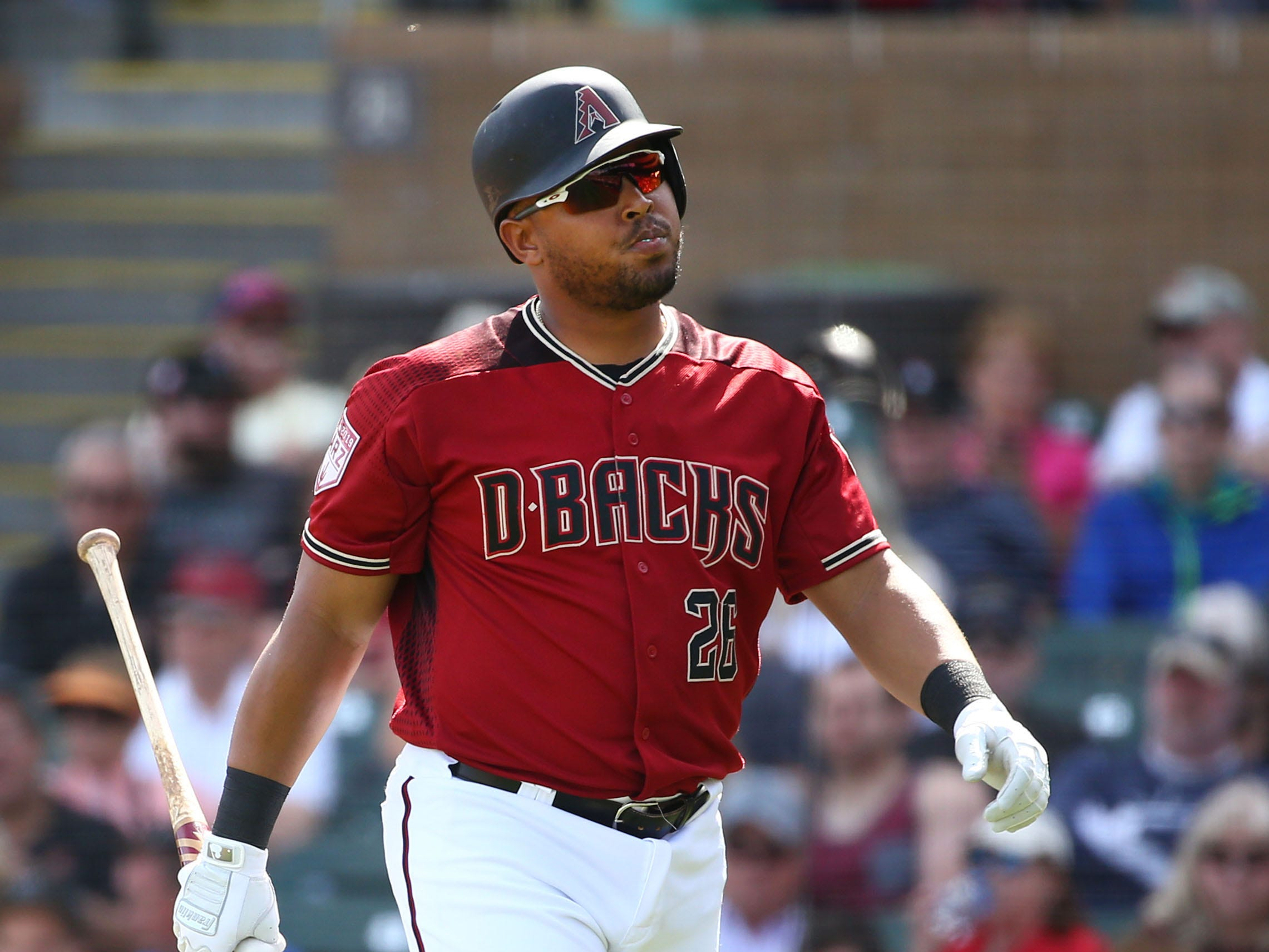 Arizona Diamondbacks Yasmany Tomas (26) strikes out against the Cincinnati Reds in the third inning during a spring training game on Mar. 4, 2019, at Salt River Fields in Scottsdale, Ariz.
