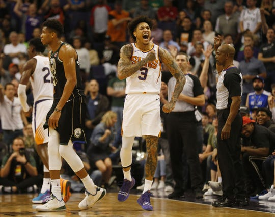 Kelly Oubre Jr. reacts during the fourth quarter of the Suns' 114-105 victory over the Bucks on March 4 at Talking Stick Resort Arena.