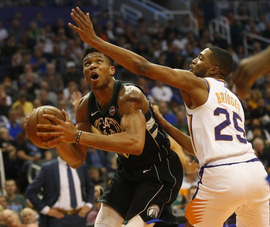 Phoenix Suns forward Mikal Bridges (25) guards Milwaukee Bucks forward Giannis Antetokounmpo (34) during the second quarter in Phoenix March 4, 2019.