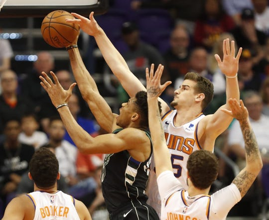 Phoenix Suns forward Dragan Bender (35) fouls Milwaukee Bucks forward Giannis Antetokounmpo (34) during the first quarter in Phoenix March 4, 2019.