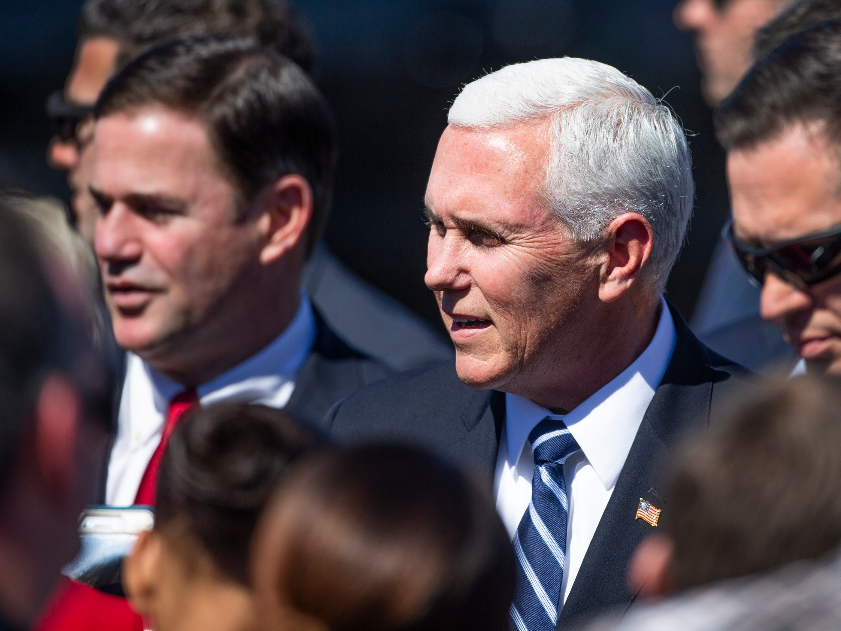 Vice President Mike Pence and Arizona Gov. Doug Ducey greet a small crowd after arriving on Air Force Two at Sky Harbor International Airport in Phoenix on March 5, 2019.