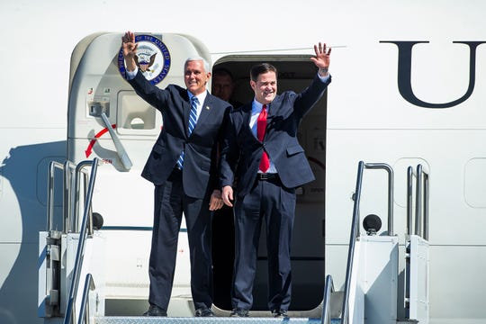 Vice President Mike Pence and Arizona Gov. Doug Ducey arrive on Air Force Two at Sky Harbor International Airport in Phoenix on March 5, 2019.