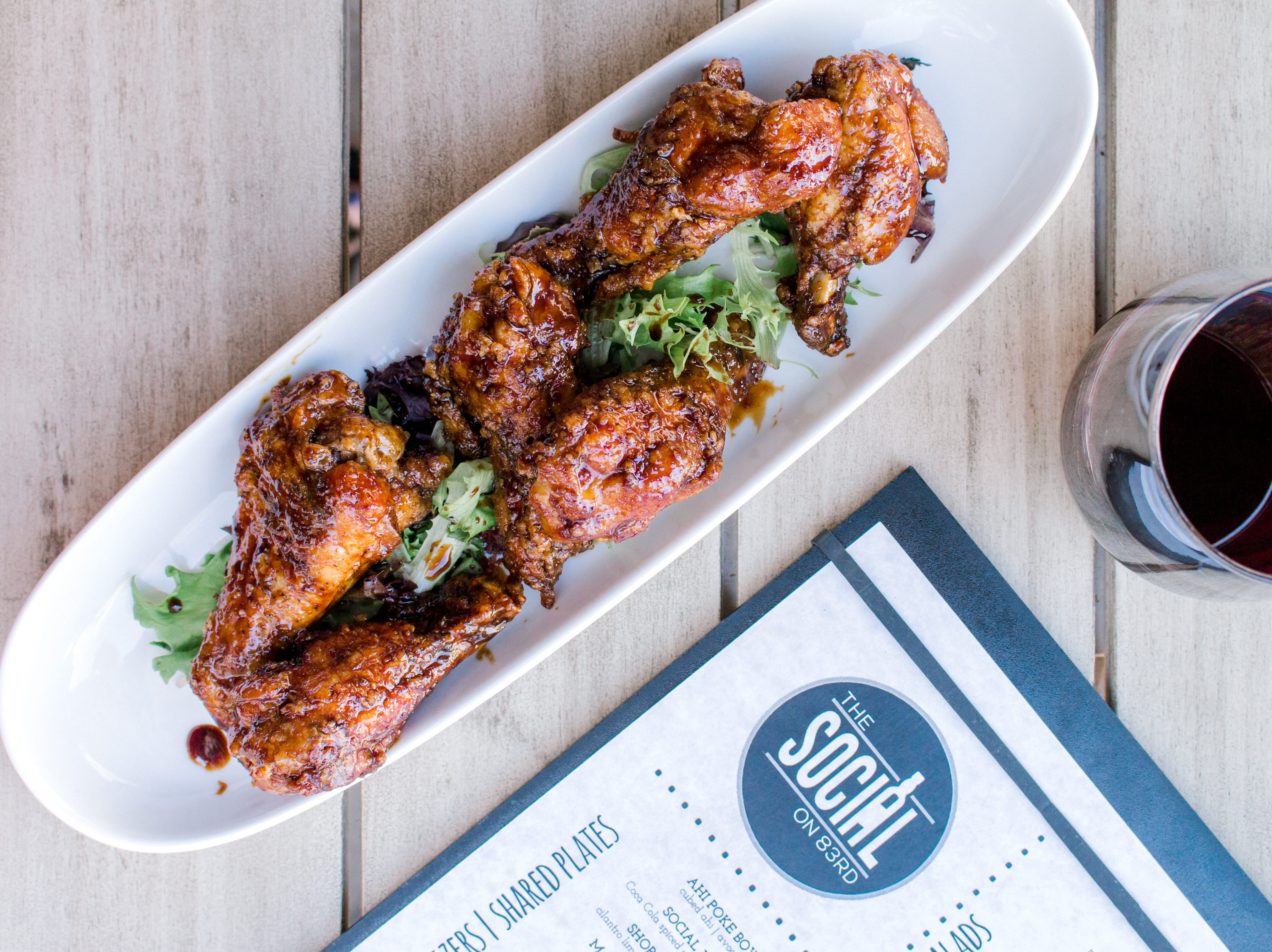 The Social on 83rd's wings are bathed in a coca cola ginger glaze.