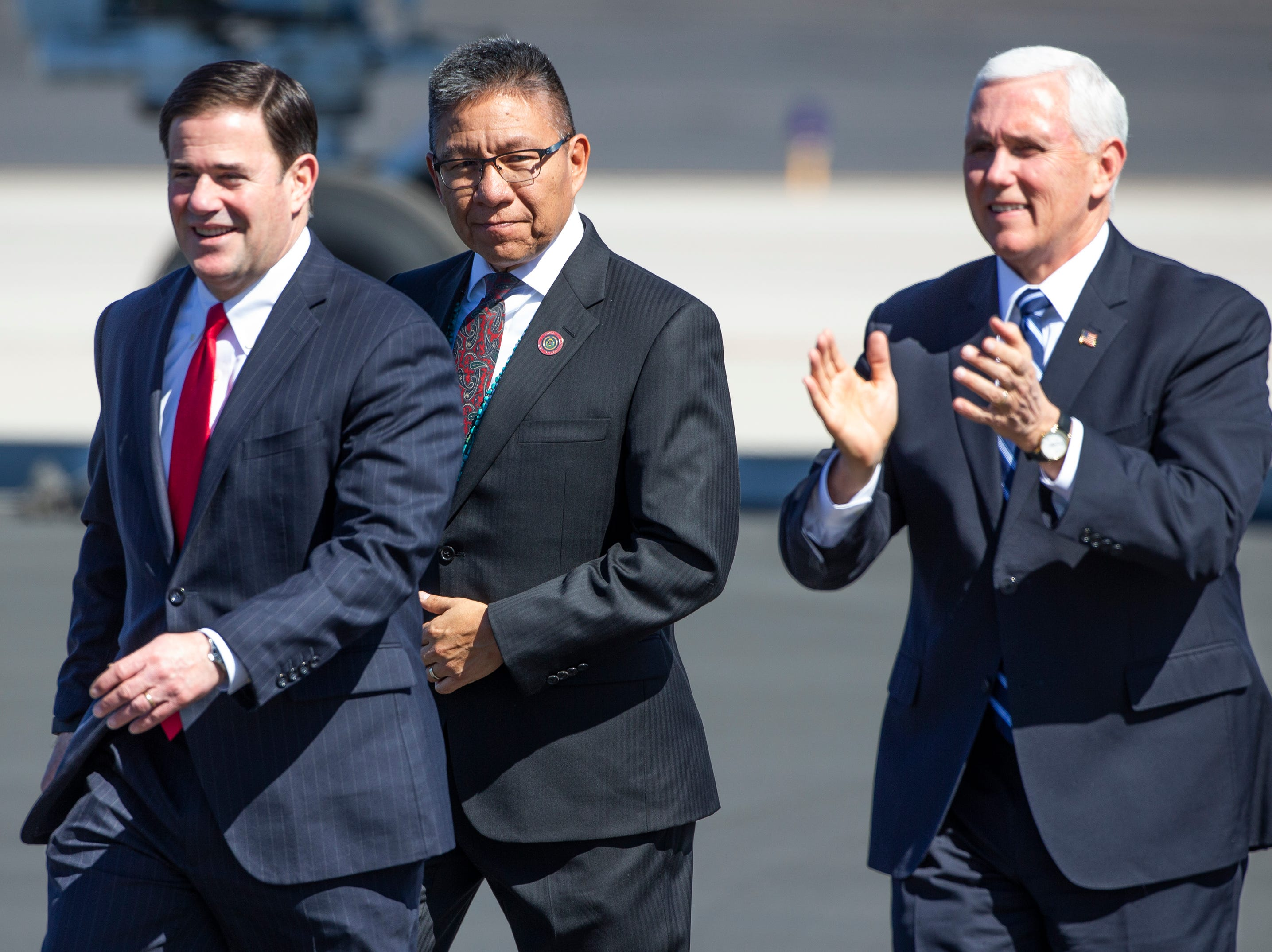 Vice President Mike Pence and Arizona Gov. Doug Ducey walk to greet a small crowd after arriving on Air Force Two at Sky Harbor International Airport in Phoenix on March 5, 2019.
