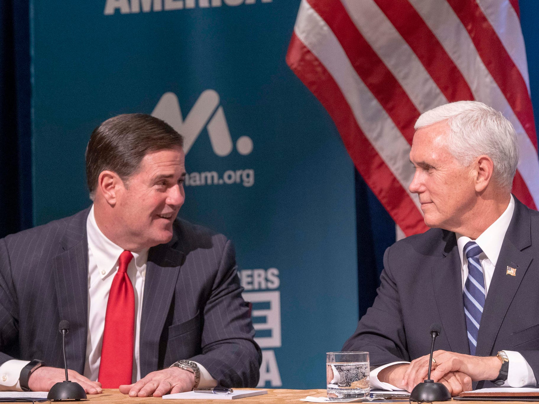 Arizona Gov. Doug Ducey (left) and Vice President Mike Pence speak during the National Association of Manufacturers meeting at the Phoenician resort in Phoenix on March 5, 2019.