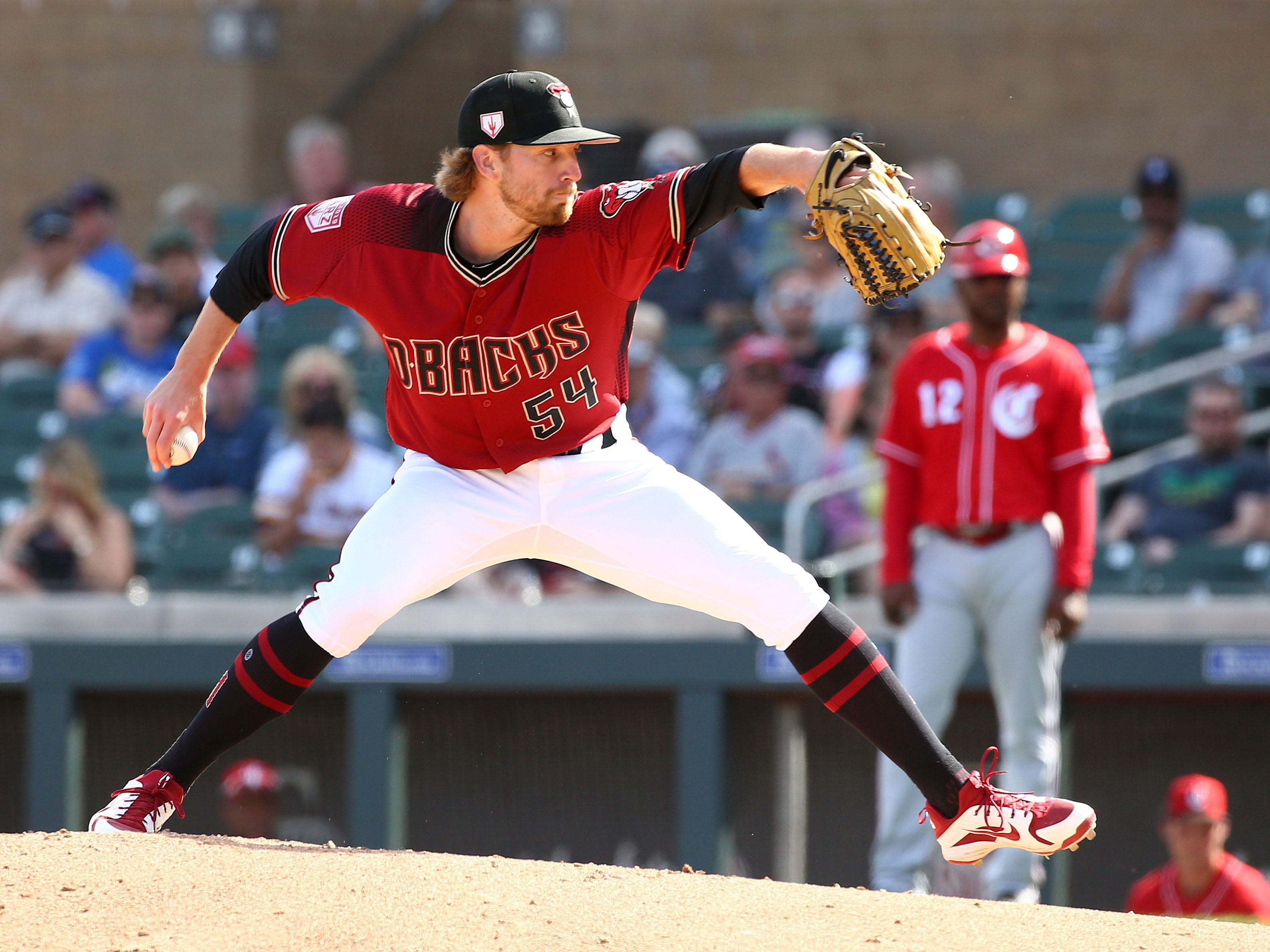 Arizona Diamondbacks pitcher Jimmie Sherfy (54) throws to the Cincinnati Reds in the fifth inning during a spring training game on Mar. 4, 2019, at Salt River Fields in Scottsdale, Ariz.