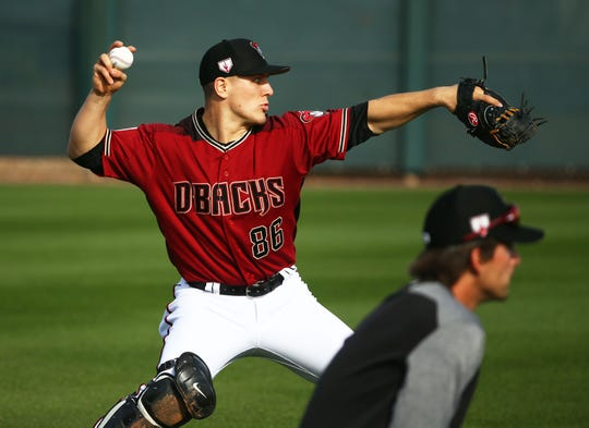 Diamondbacks catcher Daulton Varsho takes part in a drill during spring training workouts on Feb. 15 at Salt River Fields.