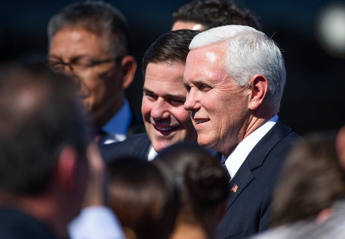 Vice President Mike Pence and Arizona Gov. Doug Ducey greet a small crowd after arriving on Air Force Two at Sky Harbor International Airport in Phoenix  March 5, 2019.