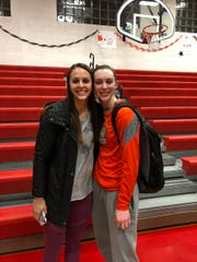 Sisters Carly, left, and Olivia Richardson celebrate Olivia reaching the career 1,000-point milestone last month.