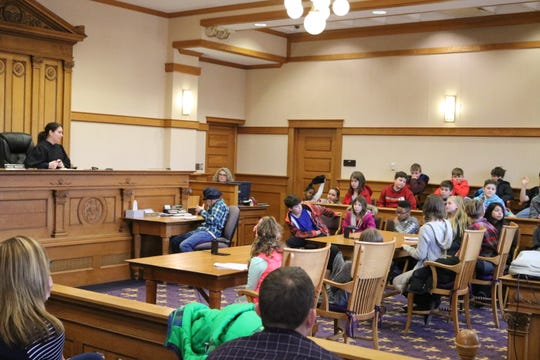 Emily Gerber, left, a magistrate in the Ottawa County Juvenile Court, presided over Bataan Memorial Intermediate School's mock trial on Tuesday.